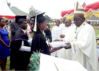 Graduands offer gifts to Mbarara Diocese Archbishop Paul Bakyenga during the Uganda Martyrs University 21st extended graduation ceremony in Mbarara Town
