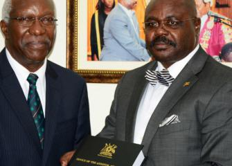 The Auditor General Mr.John-F.S Muwanga L submitting the Annual Audit Report to the Deputy Speaker of Parliament